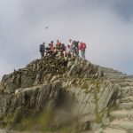 Happy climbers reach the trigpoint