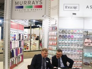 Two of the Paul Murray sales team analyse their PixSell orders